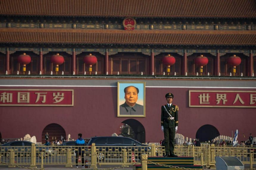 A member of China's People's Liberation Army (PLA) stands guard in front of the Chairman Mao portrait, at Tiananmen Square.