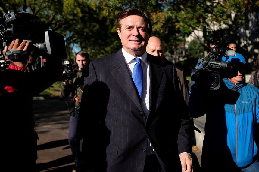 Manafort leaves the US Federal Court after being arraigned on twelve federal charges in the investigation into alleged Russian meddling.