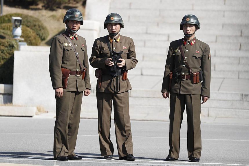 North Korean soldiers stand in the North Korea zone as US Defense Minister James Mattis and South Korean Defense Minister Song Young-Moo (both not pictured) visit the Joint Security Area (JSA) on the Demilitarized Zone (DMZ) in the border village of