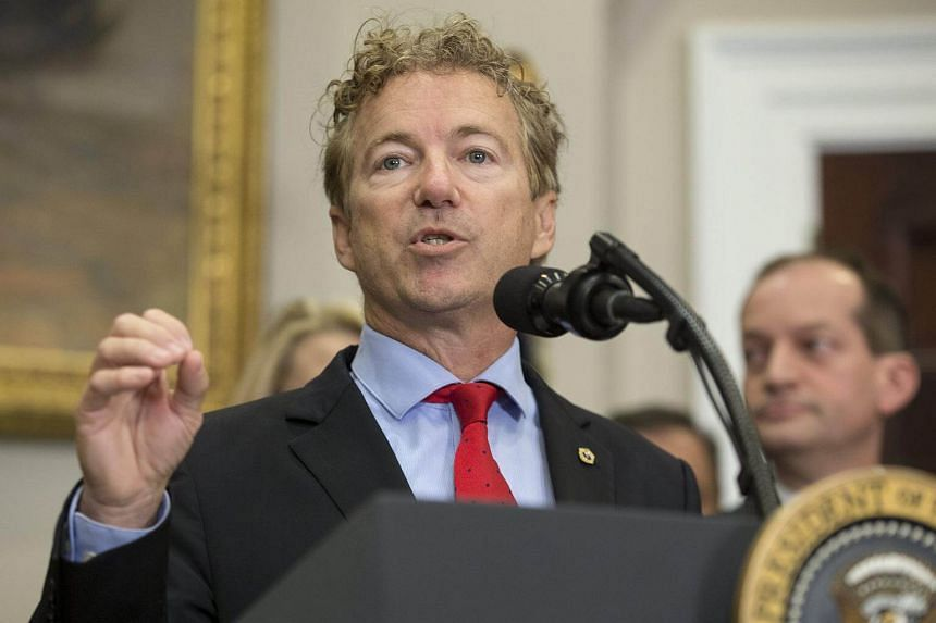 Republican Senator from Kentucky Rand Paul delivers remarks before US President Donald Trump signed an executive order on healthcare, in the Roosevelt Room of the White House.