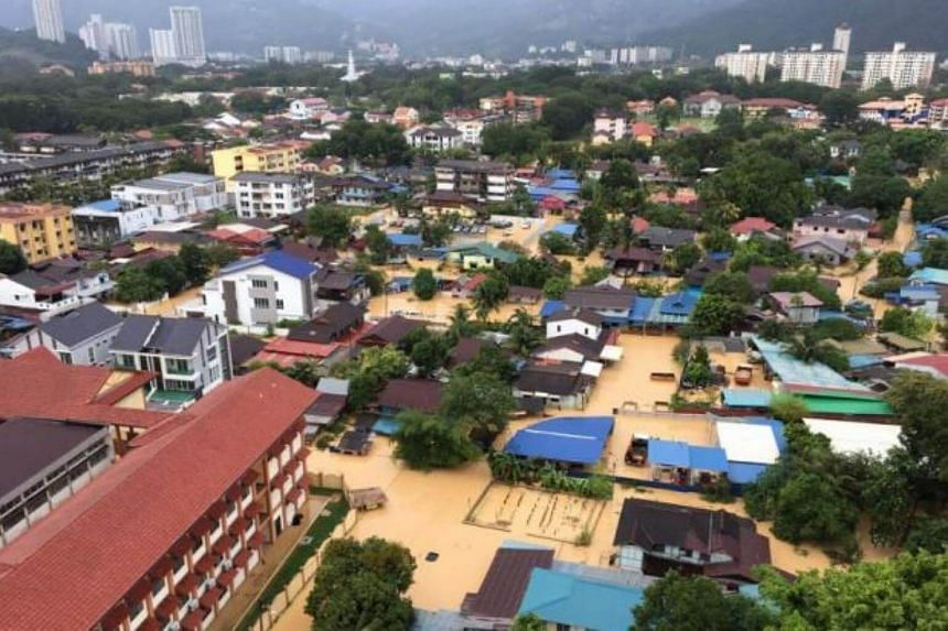 Flood waters have continued to rise in Penang, with typhoon-like winds and rain lashing the state.