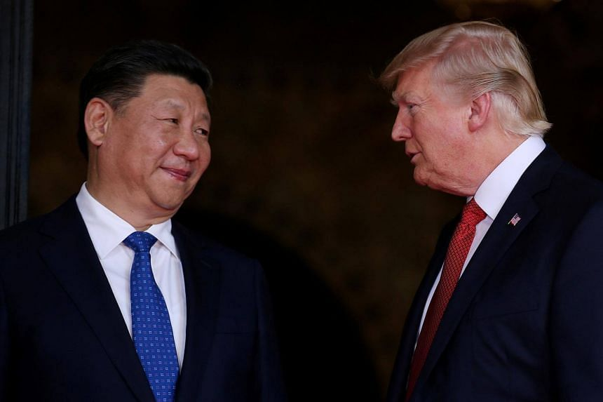 US President Donald Trump welcoming Chinese President Xi Jinping at Mar-a-Lago state in Palm Beach, Florida, on April 6, 2017.