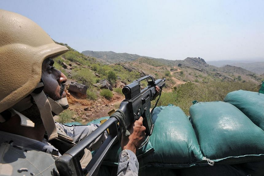 Saudi border guards keep watch along the border with Yemen in the al-Khubah area.