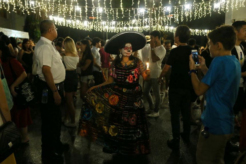 Cristina Cortes, a Mexico-born Singaporean dressed in traditional Mexican dress. She is married to a Singaporean and has been living here for 19 years.