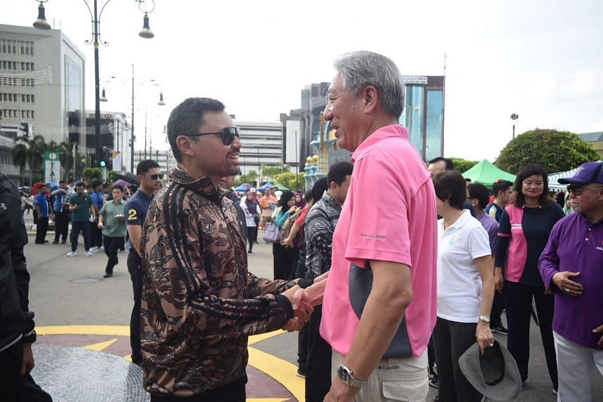 Deputy Prime Minister Teo Chee Hean and Crown Prince Haji Al-Muhtadee Billah at the morning walk.