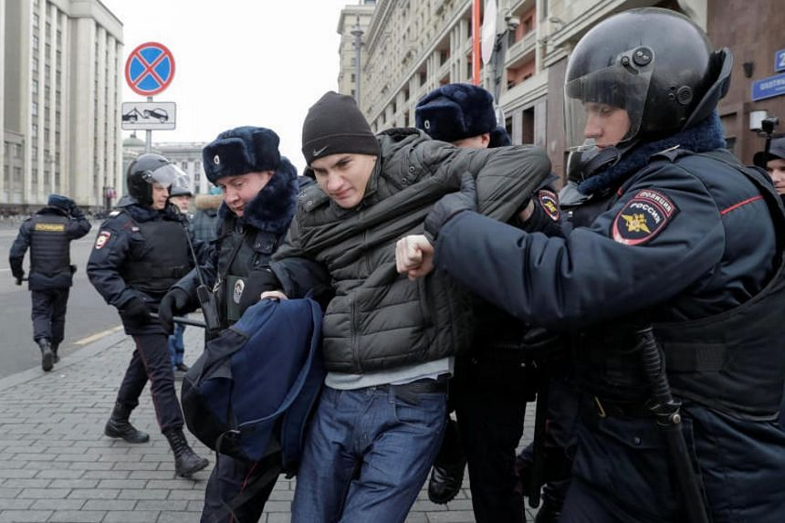 Russian police officers detaining a man suspected of being an anti-government protester, in Moscow on Nov 5, 2017.