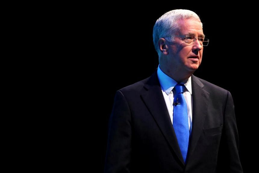 Britain's Secretary of State for Defence Sir Michael Fallon addresses the Conservative Party conference in Manchester on Oct 3, 2017.