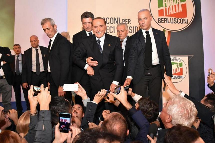 Italian former prime minister and leader of the Forza Italia party, Silvio Berlusconi (centre), during an electoral meeting in Catania, Italy, on Nov 2, 2017.