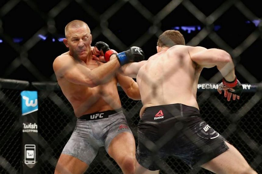 Michael Bisping throws a punch against Georges St-Pierre in the UFC middleweight championship bout at the Madison Square Garden in New York City on Nov 4, 2017.