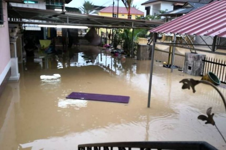 A reporter said that The Sungai Pinang river, which is just a stone's throw away from her village, swelled and spilled over its banks.