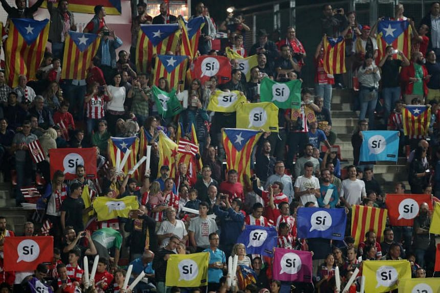 Girona fans hold up a pro Catalonia independence banners on Sept 23, 2017.