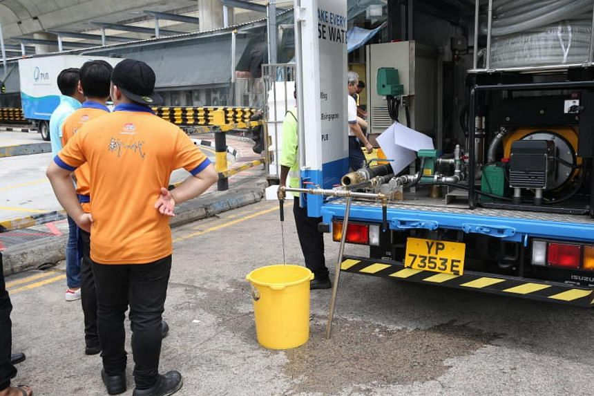Food and beverage staff collecting water from a PUB water truck at the Eastmall Link on Nov 3, 2017.