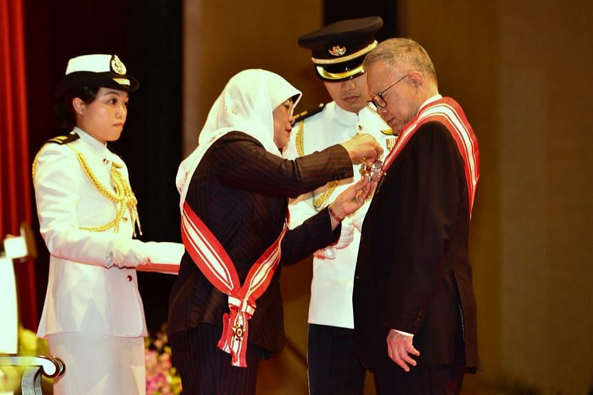 President Halimah Yacob awarding the Order of Nila Utama ( First Class ) to Mr Eddie Teo Chan Seng, chairman of the Public Service Commission, at The Investiture of the 2017 National Day Awards on Nov 5, 2017.