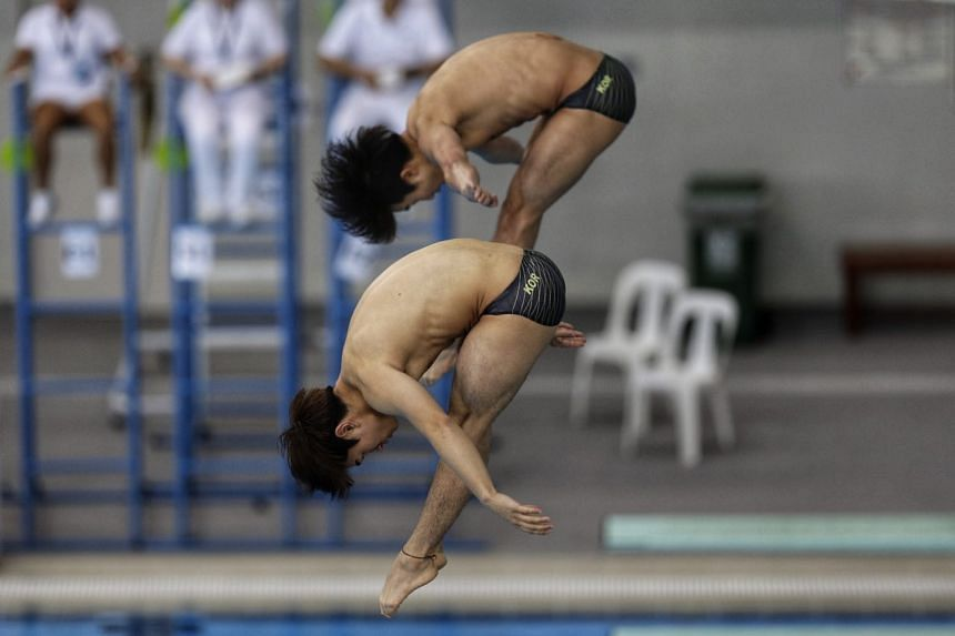 Kim Yeongnam (front) and Woo Haram of South Korea making their dive during the synchronised 3m men's final at the Diving Grand Prix at OCBC Aquatic Centre on Nov 5, 2017.