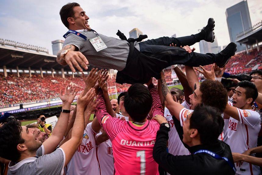 Tianjin Quanjian players throw head coach Fabio Cannavaro into the air as they celebrate their victory against Guangzhou Evergrande on Nov 4, 2017. Reports say the Italian will replace Luiz Felipe Scolari.