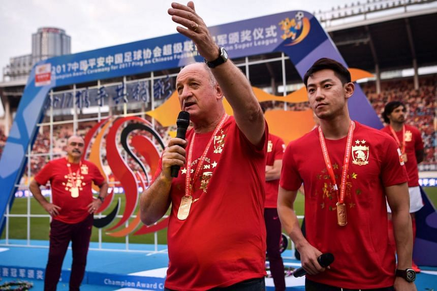 Head coach of China's Guangzhou Evergrande Luiz Felipe Scolari thanking players and fans on Nov 4, 2017, after what is expected to be his final game in charge at the freshly crowned Chinese Super League (CSL) champions.