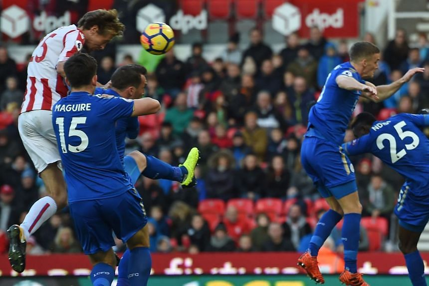 Stoke's English striker Peter Crouch climbing to head home their second equaliser in the 2-2 English Premier League draw with Leicester at the Bet365 Stadium in Stoke-on-Trent.