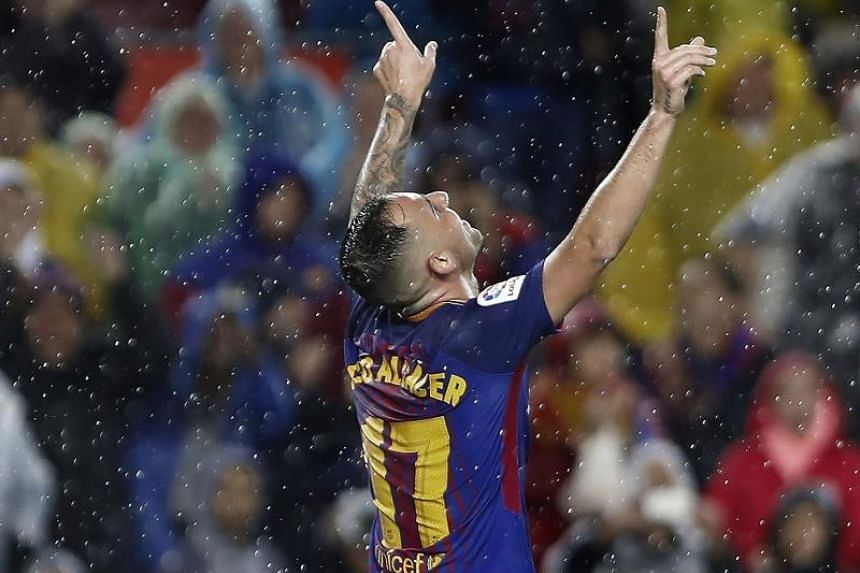 Paco Alcacer celebrates after scoring his second goal against Sevilla.