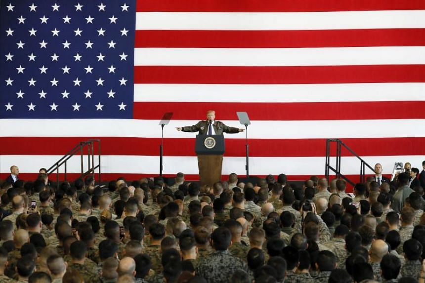 US President Donald J. Trump addresses US servicepersons at Yokota Air Base in Fussa, Tokyo.