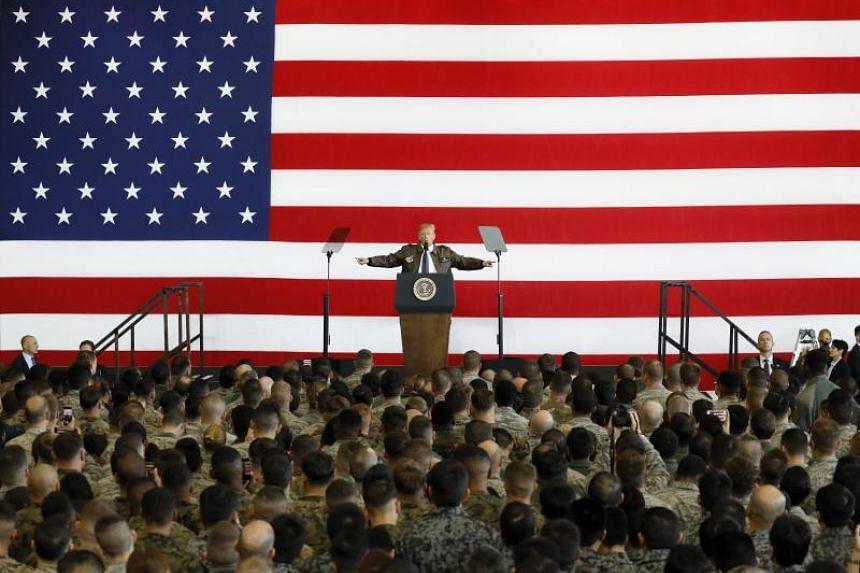 US President Donald J. Trump addresses US servicepersons at Yokota Air Base in Fussa, Tokyo.