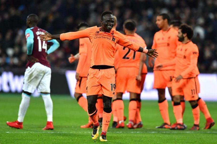 Liverpool's Senegalese midfielder Sadio Mane celebrates their fourth goal.
