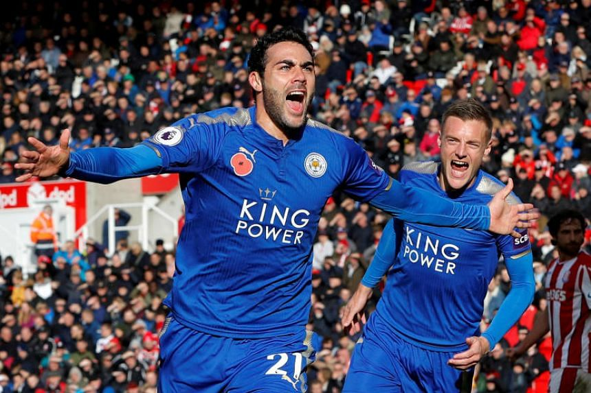 Leicester City's Vicente Iborra celebrates scoring their first goal with Jamie Vardy.