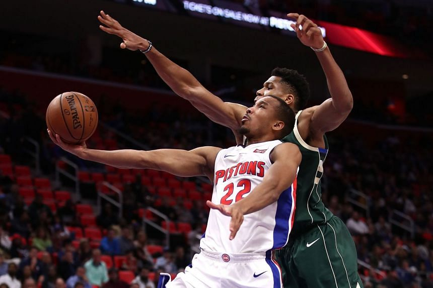 Avery Bradley of the Detroit Pistons tries to get a shot off in front of Giannis Antetokounmpo of the Milwaukee Bucks during the second half at the Little Caesars Arena on Nov 3, 2017.