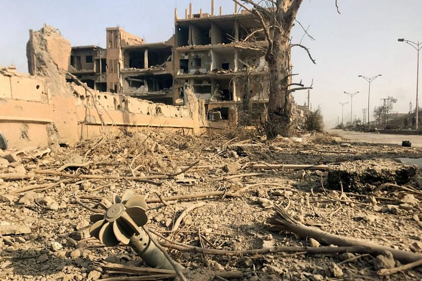 The damage in the eastern Syrian city of Deir Ezzor during a military operation by government forces against Islamic State group jihadists on Nov 4, 2017.