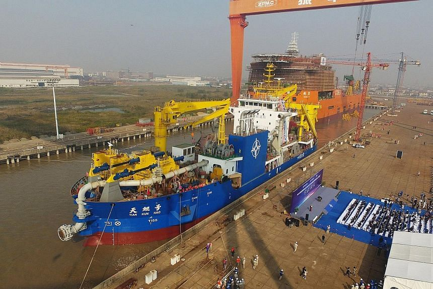 The dredger being launched at a port in Qidong in China's eastern Jiangsu province last Friday.