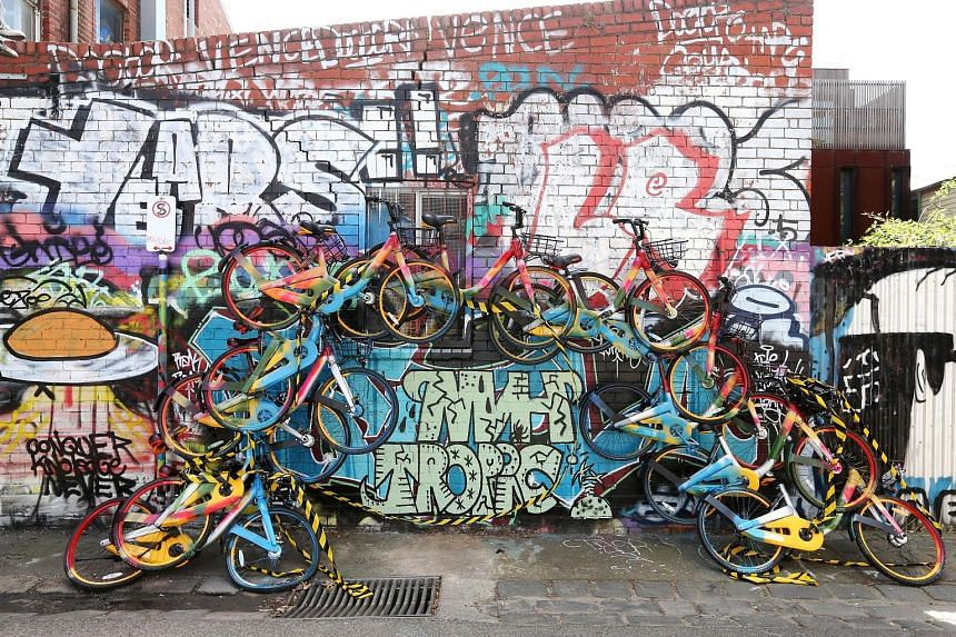 A rainbow-shaped art installation in inner-city Melbourne, made from about a dozen shared bikes. In Australia, shared bikes have ended up in trees, on top of portable toilets and in waterways.