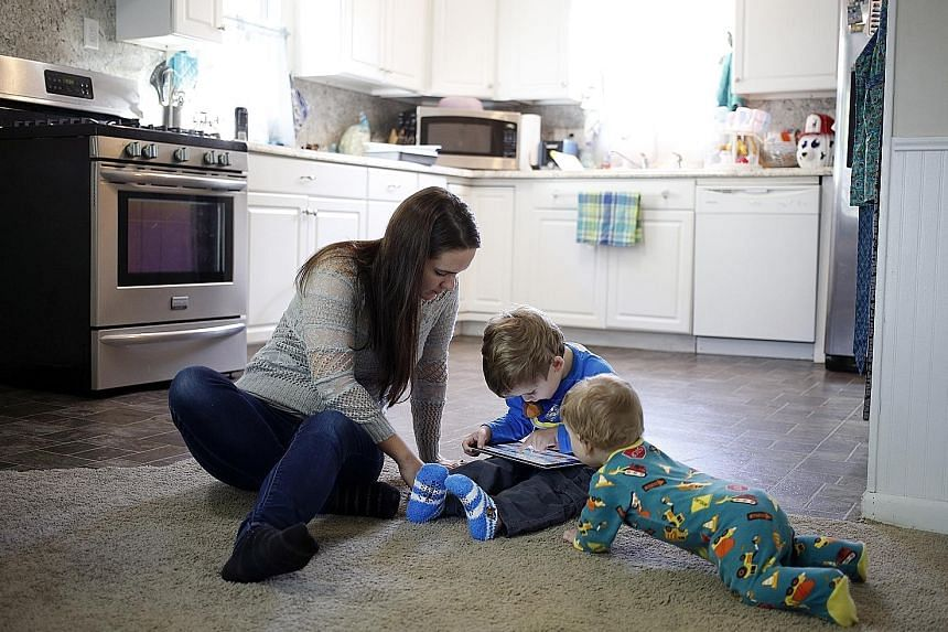 Nurse Staci Burns' three-year-old son, Isaac (centre), chanced on a clip on YouTube Kids that featured renderings of the popular Paw Patrol rescue dogs caught in a nightmarish situation. With them is her younger son, Asher, 10 months.