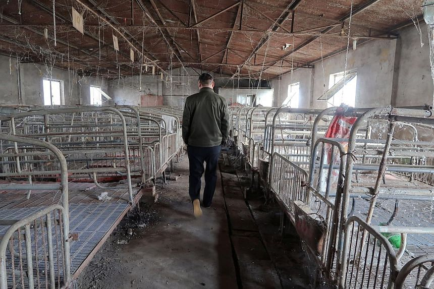"""Almost one year after a government notice to shut his pig farm on the outskirts of Beijing, Mr Zhang Faqing is still waiting for millions of yuan in compensation. """"I had to sell (my pigs) at whatever price the buyers offered, so I basically sold the"""