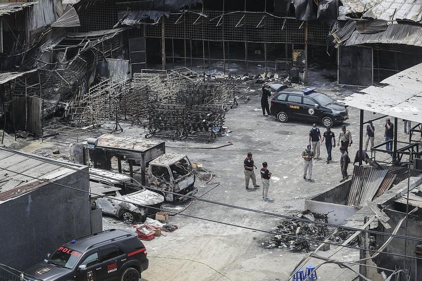 Police officers inspecting the site of the fireworks factory blaze in Tangerang, on the outskirts of Jakarta, late last month. The fire, which killed nearly 50 people, has cast a spotlight on lax safety standards in Indonesia.