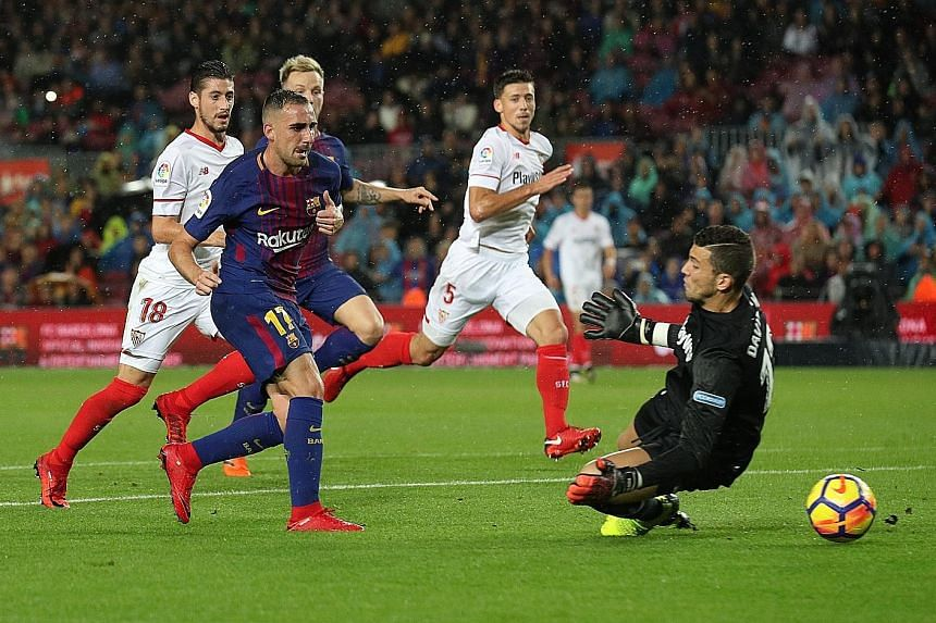 Barcelona forward Paco Alcacer slotting past Sevilla goalkeeper David Soria for their opener. He has been an option off the bench since his move last summer from Valencia but his brace puts him in line for a starting place.