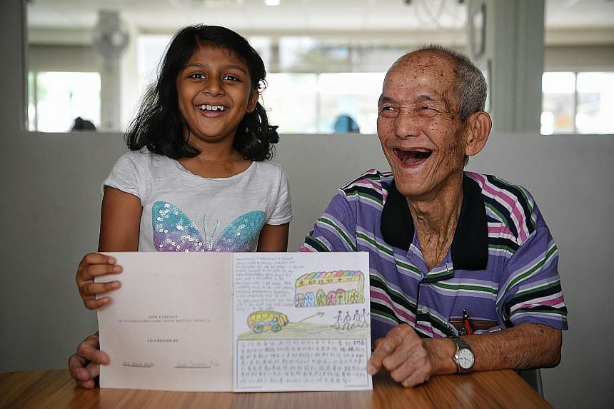 Primary 2 pupil Dayna Shanaia Maha and retiree Ang Peng Hong co-wrote a book about the importance of being happy.