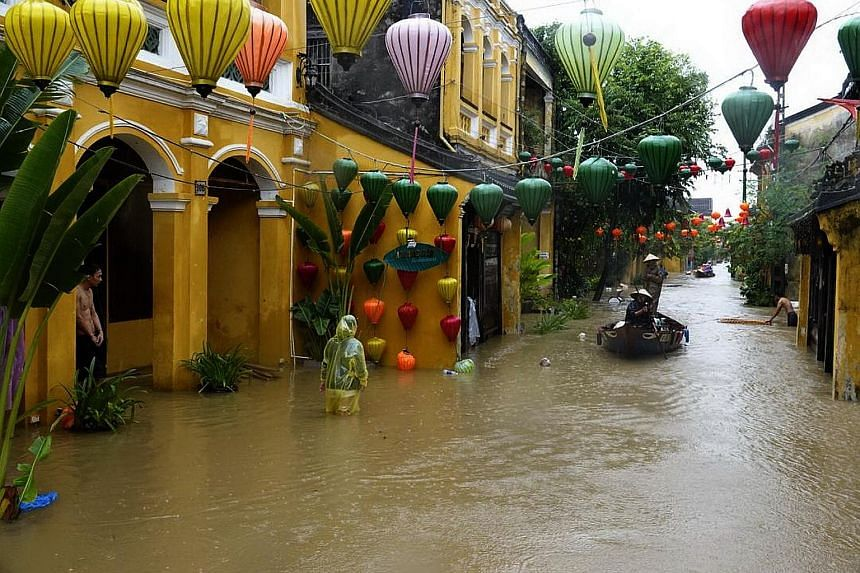Floodwater was up to 1.5m deep in some parts of the popular tourist town of Hoi An yesterday after Typhoon Damrey barrelled into Vietnam. More than 30,000 people, including tourists, were evacuated ahead of the storm, which saw heavy rain and 130kmh