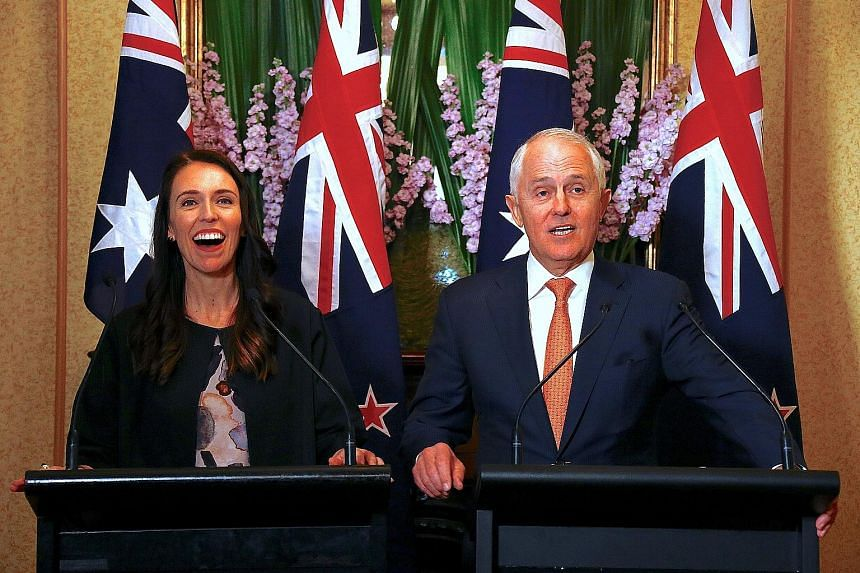 Australian Prime Minister Malcolm Turnbull and his New Zealand counterpart Jacinda Ardern at a press conference in Sydney yesterday.