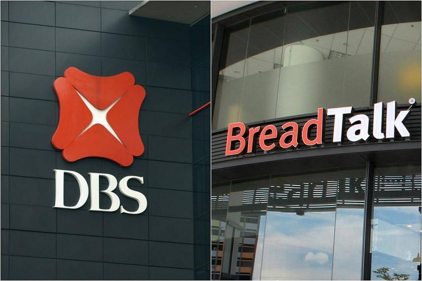 DBS's earnings fell 25 per cent for the third quarter from a year ago to S$802 million, while BreadTalk Group announced a 22.2 per cent rise in third-quarter net profit.