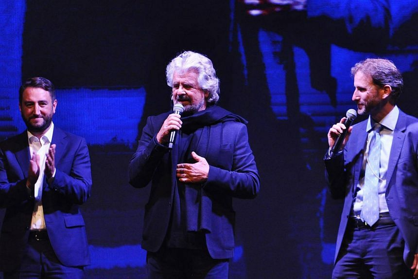 Italian anti-establishment Five Star Movement (M5S) leader, Beppe Grillo (centre) addresses supporters during a campaign meeting to support M5S candidate Giancarlo Cancelleri (left) upon regional elections in Sicily.
