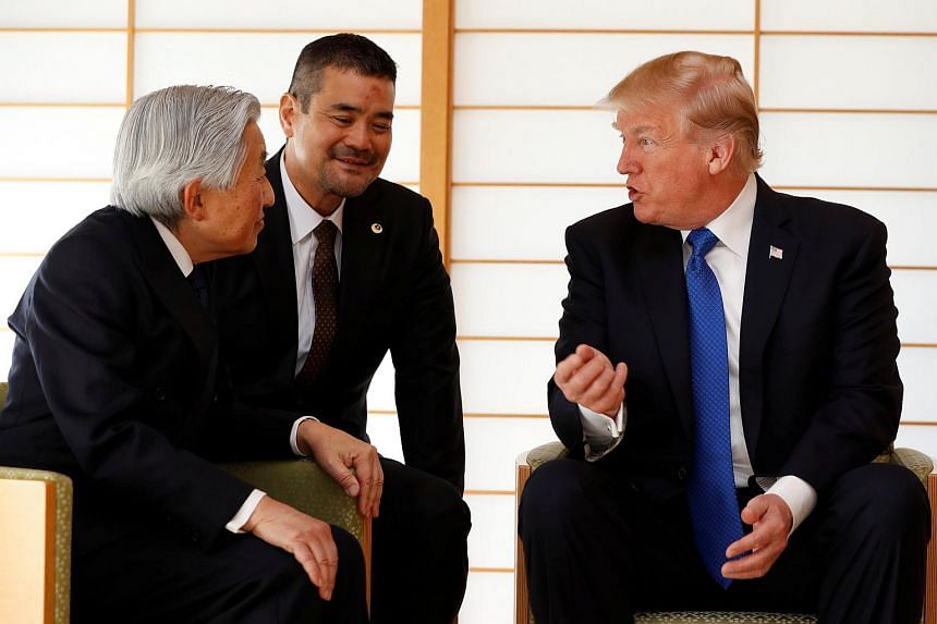 US President Donald Trump talks with Japan's Emperor Akihito during their meeting at the Imperial Palace in Tokyo, Japan on Nov 6, 2017.