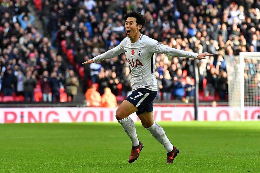 Tottenham Hotspur's South Korean striker Son Heung Min celebrates scoring the opening goal during the English Premier League football match between Tottenham Hotspur and Crystal Palace at Wembley Stadium in London.