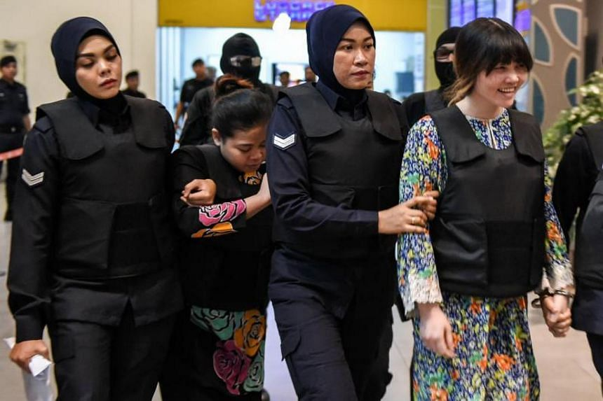 Vietnamese defendant Doan Thi Huong and Indonesian defendant Siti Aishah during a visit to the scene of the murder as part of the Shah Alam High Court trial process on Oct 24, 2017.