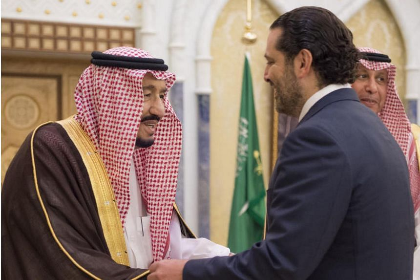 King Salman bin Abdulaziz al-Saud (left) greets former Lebanese prime minister Saad Hariri in Riyadh, on Nov 6, 2017.