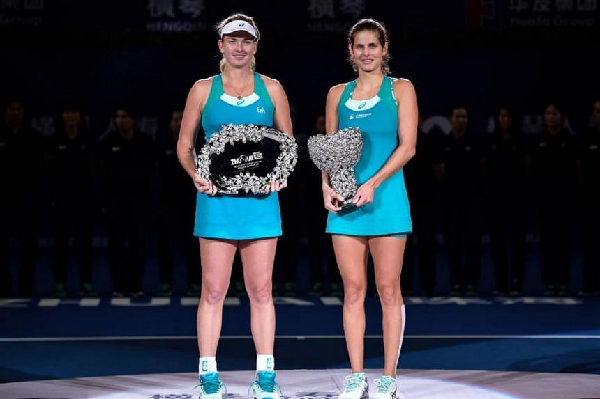 Julia Goerges of Germany (right) celebrates after her victory against Coco Vandeweghe in the women's singles final at the Zhuhai Elite Trophy tennis tournament in south China's Guangdong province on Nov 5, 2017.