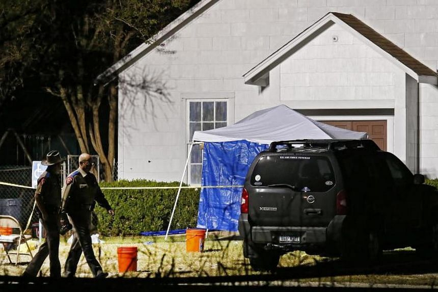 Police officers walks past cars and shot out windows of the church while investigators work at the scene of a mass shooting at the First Baptist Church in Sutherland Springs, Texas, on Nov 6, 2017.