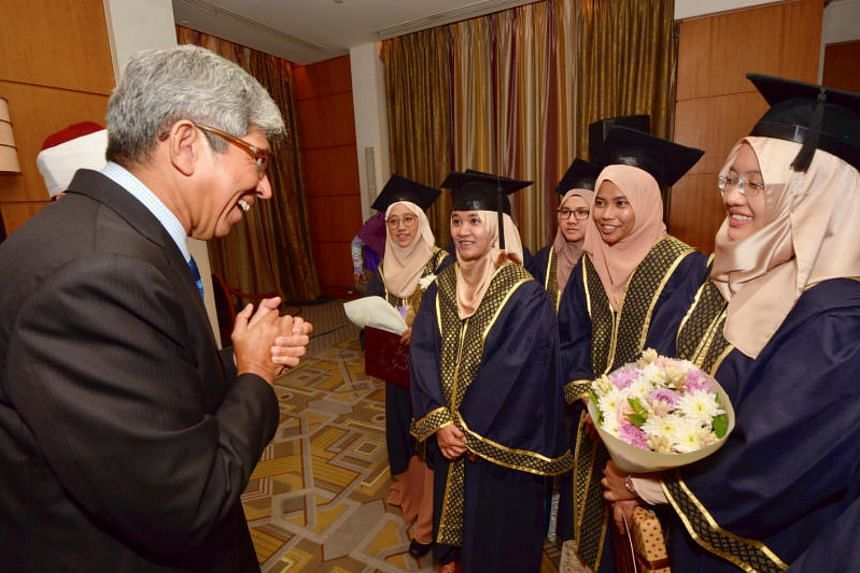 Minister-in-charge of Muslim Affairs Dr Yaacob Ibrahim speaking with graduates from the Al Azhar University in Egypt, at the Four Seasons Hotel in Cairo, on Nov 5, 2017.