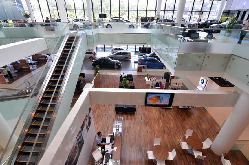 The BMW showroom in Alexandra Road. Some one million cars were recalled by the company in North America due to problems that posed fire risks.