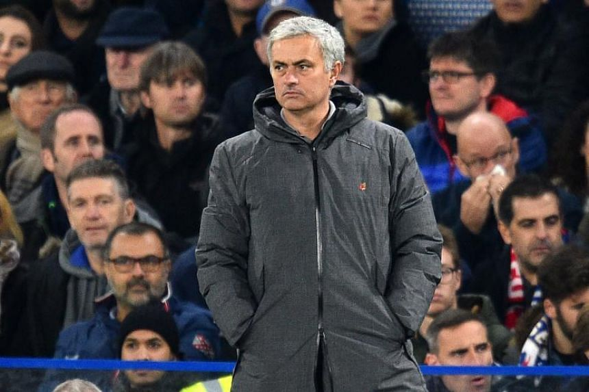 Manchester United's Portuguese manager Jose Mourinho watches from the touchline during the second half of the English Premier League football match between Chelsea and Manchester United at Stamford Bridge in London on Nov5, 2017.
