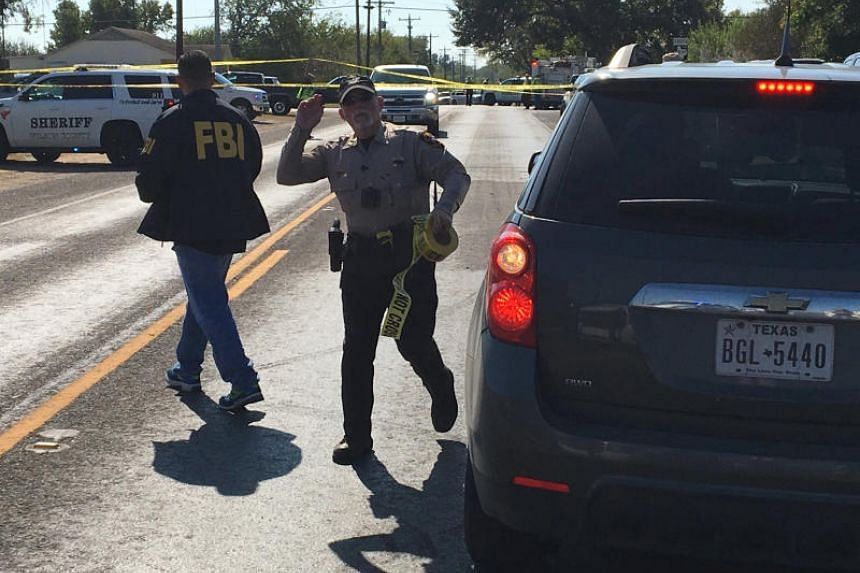 FBI officials arrive at the site of a mass shooting in Sutherland Springs, Texas, US on Nov 5, 2017.