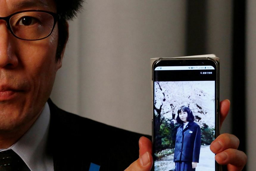 Takuya Yokota shows a picture of his sister Megumi Yokota, a Japanese national abducted by North Korean agents decades ago as a schoolgirl, on his smartphone during an interview with Reuters in Tokyo, Japan, on Oct 26, 2017.